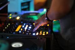 DJ Mixing Party Stock Photos