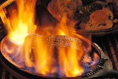 Steak flambe Stock Photos