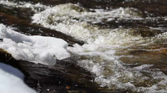 Ice floes in the river above the rapids Stock Footage