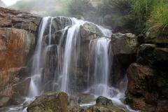 Falls on a thermal stream Stock Photos