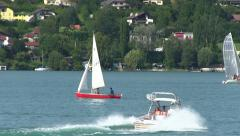 Watersports, Sailingboat, motorboat and waterskiing Stock Footage