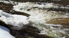 Ice floes with the sun's rays in the river above the rapids Stock Footage