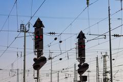 railway signal and overhead wiring - stock photo