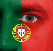 Face with the portuguese flag painted on it Stock Photos