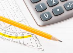 close-up of protractor, calculator, and pencil - stock photo