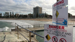 Warning signs at swimming pool, Sydney Stock Footage