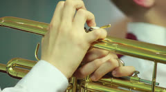 Hand wind instrument - stock footage