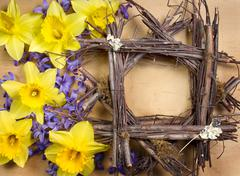 Twig frame with daffodil and hyacinth Stock Photos