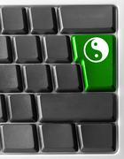 computer keyboard with yin yan key - stock illustration