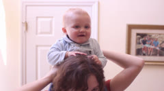 Baby going for a ride through the house Stock Footage