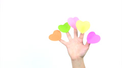 Fingers with hearts bent - stock footage