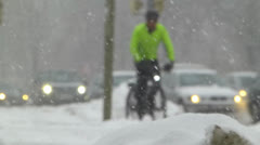 Slow Motion Commuter Cyclist Biker heavy Winter extreme snow stormy weather Stock Footage