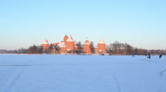 Evening sunset Trakai castle snow people tourists leisure Stock Footage