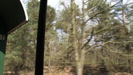 Stock Video Footage of vehicle shot traditional rail coach rides along mixed forest + pan
