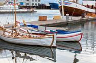 Typical iceland harbor with fishing boats Stock Photos