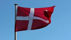 Flag of Denmark against the blue sky Stock Footage