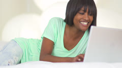 African woman typing on laptop - stock footage