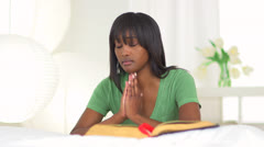 Black woman praying - stock footage