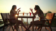 Stock Video Footage of Friends chatting in sunset