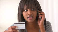 Black woman calling to make a purchase Stock Footage