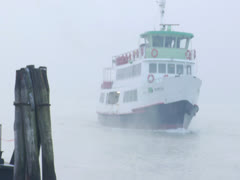 Boat Sails Through Mist Sailing over Winter Water to Boating Dock  Stock Footage