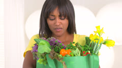 Black woman carrying groceries Stock Footage