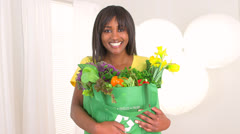 Happy black woman holding groceries Stock Footage