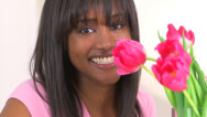 Black woman smiling with bouquet of flowers Stock Footage