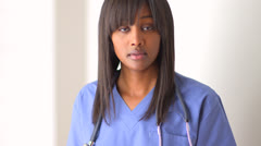 Black woman doctor looking at camera Stock Footage
