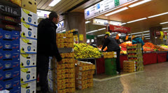 Turkish grocery vegetable stall at Germany Frankfurt subway metro station Stock Footage
