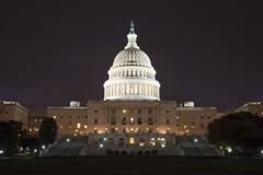the us capitol in the night - stock photo