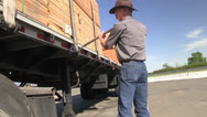 Big rig truck driver, securing load Stock Footage