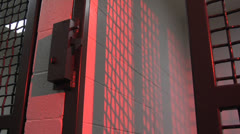 Jail door closes  and latches with dramatic red lighting and echo Stock Footage