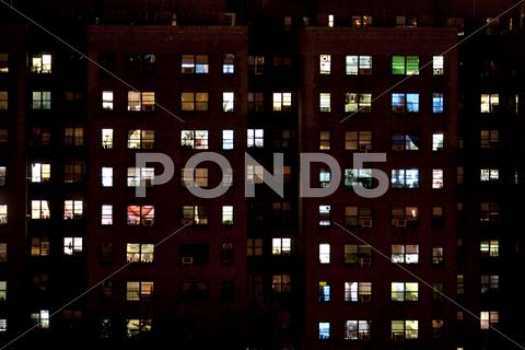 Stock photo of block of flats at night