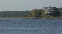 Water,  LIVE OAK ISLAND FLORIDA STILT HOUSE  ON WALKER CREEK Stock Footage