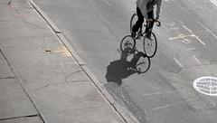 Shadow of cyclist Stock Photos