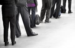 People in queue Stock Photos