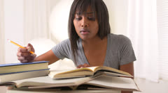 Black woman college student studying for finals Stock Footage