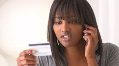 African woman calling to make a purchase Stock Footage