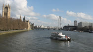 Stock Video Footage of Canoeists on river Thames with Houses of Parliament London