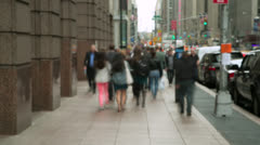 Crowd of people walking time-lapse on city street zoom in Stock Footage