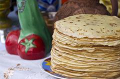 shrovetide pancakes on a festive table - stock photo