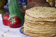 Stock Photo of shrovetide pancakes on a festive table