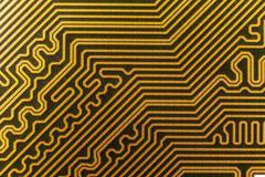 yellow computer circuit board close-up - stock photo