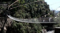 River Bridge In Rural Nepal Buddhist Prayer Flags Stock Footage