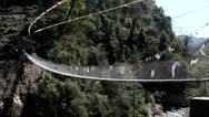 Stock Video Footage of River Bridge In Rural Nepal Buddhist Prayer Flags
