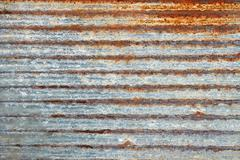 Ribbed metal plate with shelled paint Stock Photos