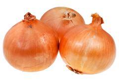 Three onion bulbs Stock Photos