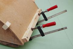 clamps are used for gluing  workpiece - stock photo