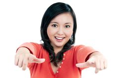 happy young woman pointing - stock photo